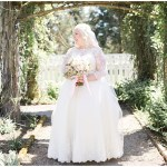 Lace wedding dress with blush and white bridal bouquet, navy and pink southern wedding | Ivan & Louise Images and Jessica Dum Wedding Coordination