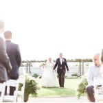 Bride and father of the bride ceremony entrance, navy and pink southern wedding | Ivan & Louise Images and Jessica Dum Wedding Coordination