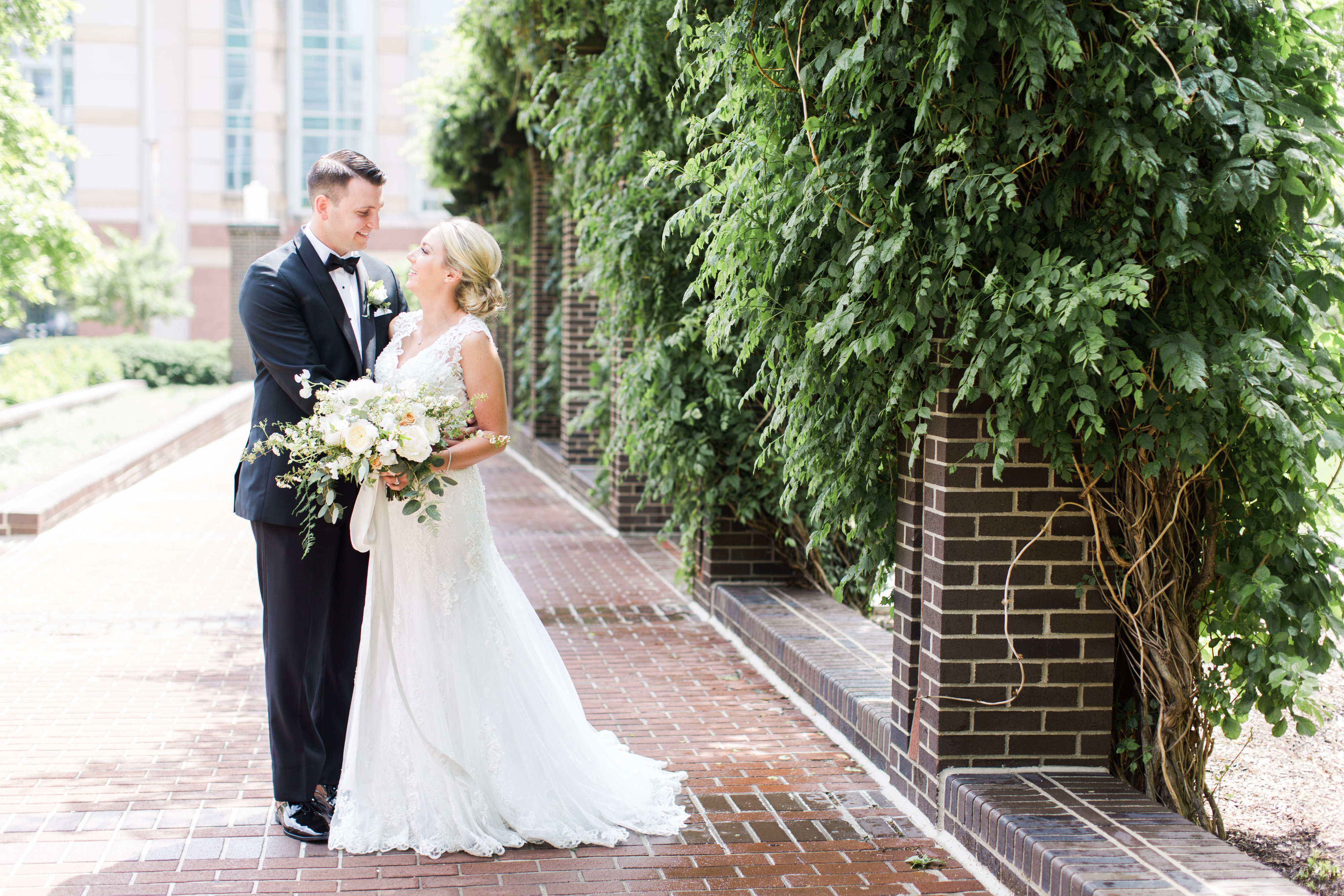 lace wedding dress; ivory bridal bouquet with greenery; Scottish Rite Cathedral Indianapolis Wedding; neutral floral and greenery wedding| Ivan & Louise Images and Jessica Dum Wedding Coordination