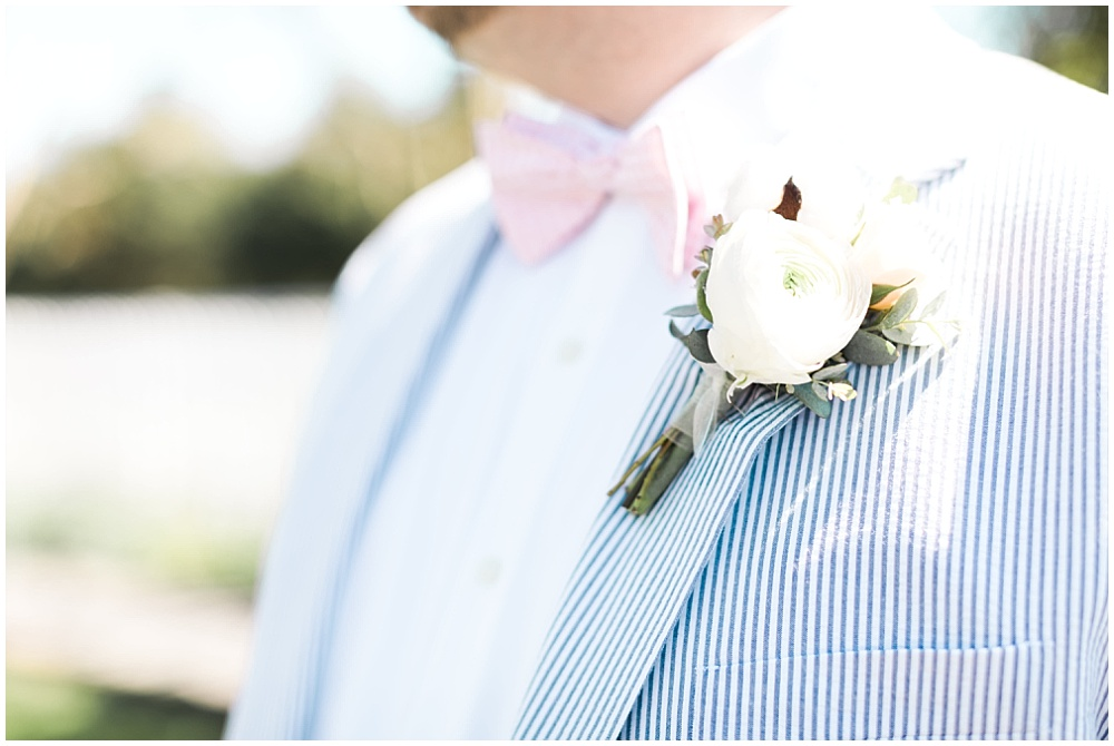 Blue striped groom suit with pink bow tie, navy and pink southern wedding | Ivan & Louise Images and Jessica Dum Wedding Coordination