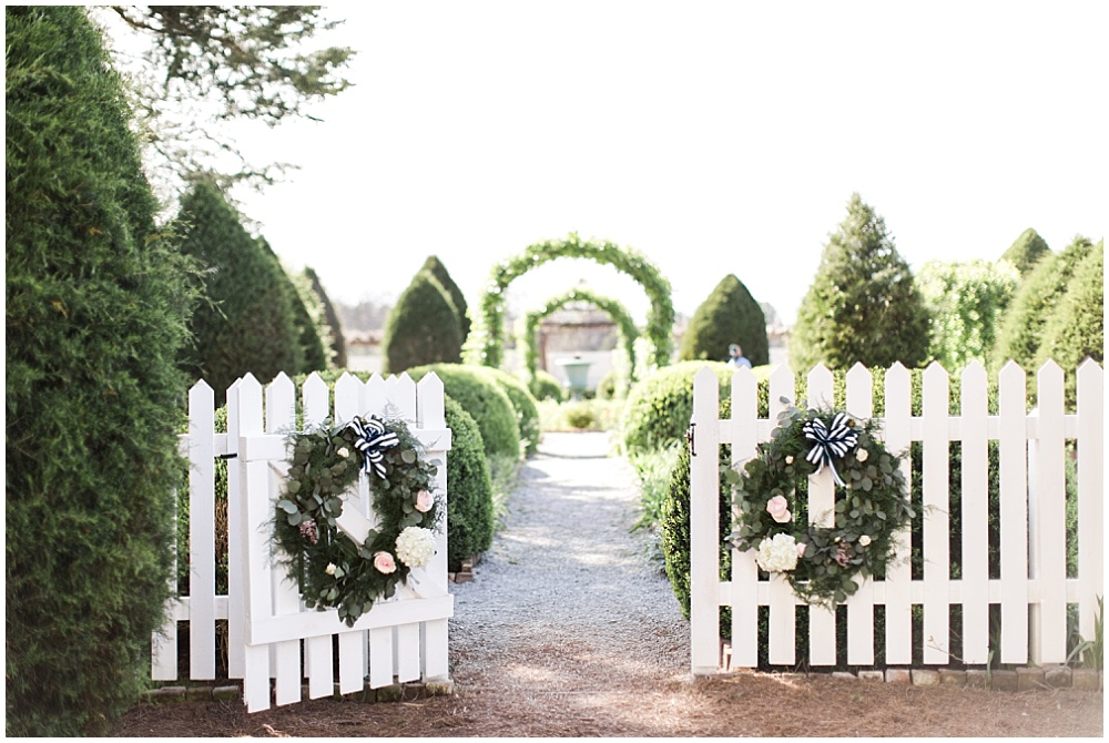 Charming reception entrance with floral wreaths, navy and pink southern wedding | Ivan & Louise Images and Jessica Dum Wedding Coordination