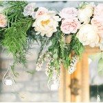 suspended head table florals; blush and peach wedding flowers with greenery; Spring floral + gold wedding | Ivan & Louise Images | Jessica Dum Wedding Coordination