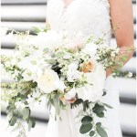 ivory and blush bridal bouquet with greenery; white v-neck lace wedding dress; Scottish Rite Cathedral Indianapolis Wedding; neutral floral and greenery wedding| Ivan & Louise Images and Jessica Dum Wedding Coordination