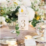 ivory and gold table numbers with gold stands; ivory and blush centerpieces with greenery; ; Scottish Rite Cathedral Indianapolis Wedding; neutral floral and greenery wedding| Ivan & Louise Images and Jessica Dum Wedding Coordination