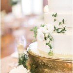white wedding cake with greenery sprigs; gold cake stand; ivory and gold wedding; Scottish Rite Cathedral Indianapolis Wedding; neutral floral and greenery wedding| Ivan & Louise Images and Jessica Dum Wedding Coordination