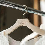wooden engraved wedding hanger; white lace wedding dress; Mexican inspired gold & floral wedding; Crowne Plaza Indianapolis Downtown Union Station; neutral floral and greenery wedding|Cory + Jackie and Jessica Dum Wedding Coordination
