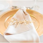 gold laser cut place cards; esposa placecard; Pirouette Paper; gold chargers; rose napkin fold; Mexican inspired gold & floral wedding; Crowne Plaza Indianapolis Downtown Union Station; neutral floral and greenery wedding|Cory + Jackie and Jessica Dum Wedding Coordination