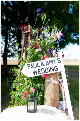 A gorgeous DIY inspired wedding sign with country flowers