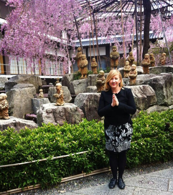 Lily in Kyoto with buddhas and blossoms