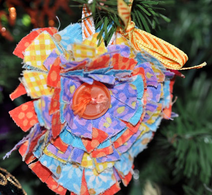 Fabric scaps, buttons and ribbon make pretty and colorful ornaments.