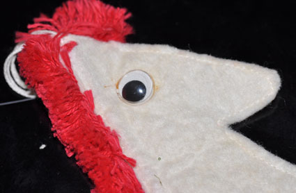 Felt horse head ornament with googly eyes.
