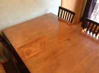 We put a glass top on our wooden kitchen table - Jill Cataldo