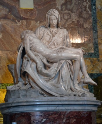 Photograph of Michelangelo's Pieta at the Vatican. Mary holding the dead Jesus across her lap.