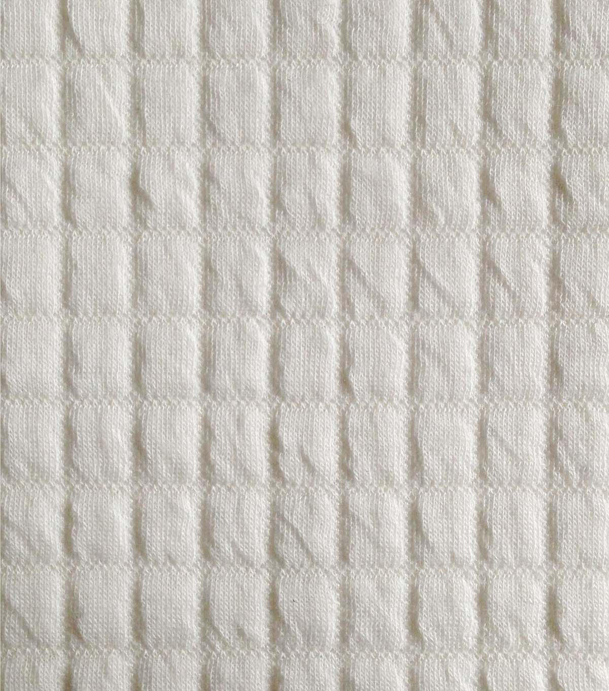 Quilted Fabric Doodles Collection Majestic Quilted Solid Knit Fabric Ivory