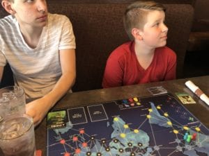 playing the board game, pandemic on Father's Day at Mr. Mikes.