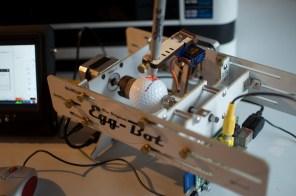 A Raspberry Pi controlled Eggbot printing on a golf ball