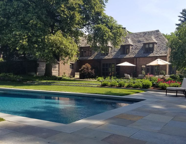 Charles Lewis Bowman home with pool and landscaping by Johnsen