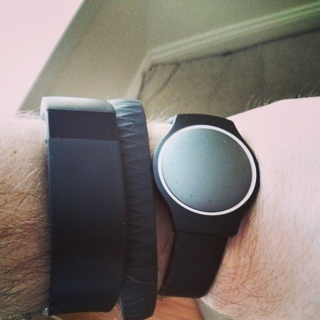 a collection of three fitness trackers on my wrist