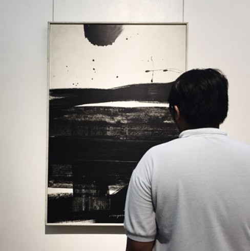 Gerald looking at a painting