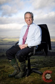 Seated corporate portrait in the middle of the North Yorkshire Moors