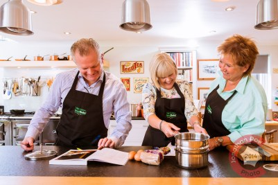 Sue, far right, starts off the cooking with guests at the Kitchen Social