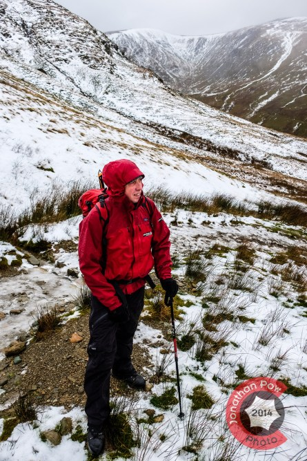 Graham stops to enjoys the view on his ascent, snow starts to appear on higher ground at around 500m