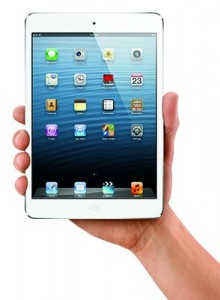 Hand holding an iPad mini.