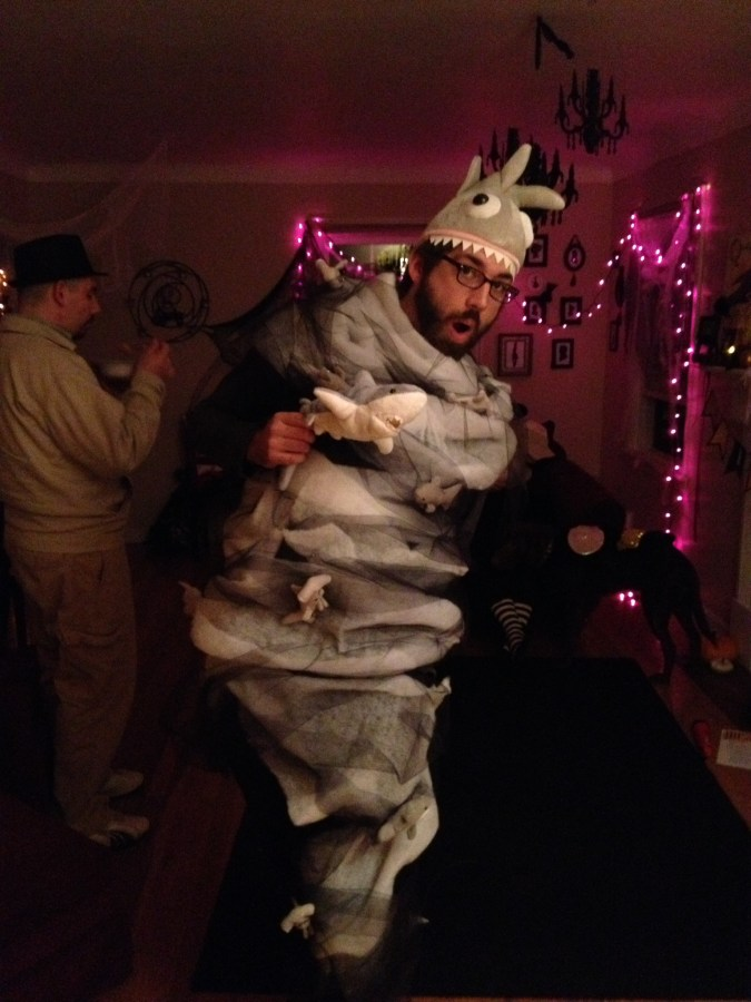 Man dressed as a Sharknado poses at Halloween party.