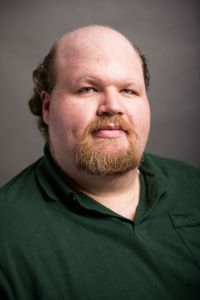 This is me, in my official Delta State faculty photo. It was taken in August 2014, and since then I haven't lost any more hair. So I'd say that's a success.