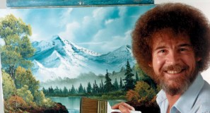"""This undated image released by Copyright Bob Ross Inc./The Joy of Painting, shows the late Bob Ross, host of the PBS series """"The Joy of Painting."""" PBS said Thursday it's posted a video remix with clips from """"The Joy of Painting"""" instructional series, featuring the late Bob Ross. The """"Happy Painter"""" remix is from John Boswell, who created the """"Garden of Your Mind"""" video tribute to Fred Rogers. That mashup of clips from """"Mister Rogers' Neighborhood"""" has been viewed nearly 6 million times on YouTube. """"The Joy of Painting,"""" still seen in repeats, aired on PBS from 1983 to 1994 with its bushy-haired, mellow-voiced host. Ross died in 1995. (AP Photo/Copyright Bob Ross Inc. ® The Joy of Painting)"""