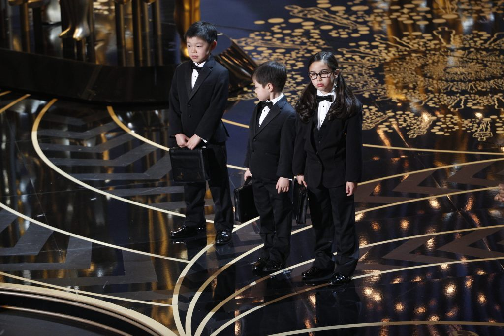 """It wasn't until the rehearsals, after Estie Kung, right, ""got her tux fitted and was already looking forward to the opportunity to be on the Oscars, that her parents heard the entirety of the joke for the first time,"" Ada Tseng wrote. (Credit: oscar.go.com)"