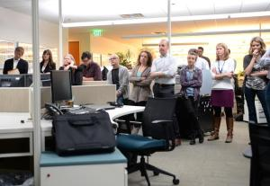 """Denver Post staff members listen as Moore resigns from the paper, saying, """"it's time for a fresh voice to lead from the corner office."""""""