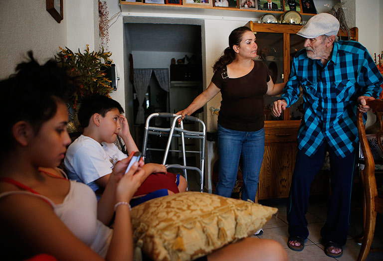 Since Gloria, center right, was banned from returning to the United States six years ago, her husband, Arsenio, who is nearly twice her age, and the children visit her in Nogales, Sonora, Mexico, every other weekend. (Credit: Mike Christy/Arizona Daily Star)