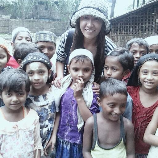 "Esther Htusan with children of the Rohingya Muslim minority in the western part of the country. ""The photo was taken in May 2013 when I started actually working on reporting in the issues of oppression and discrimination against the Rohingya Muslims by the Buddhist majority,"" Htusan told Journal-isms."