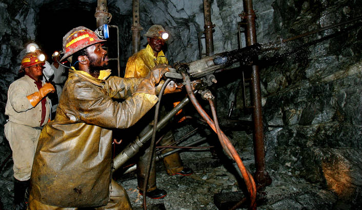 Rock drilling in a deep- level South African gold mine. Suddenly, the checks to the widows and orphans of mine workers stopped. (Credit: dailymaverick.co.za)