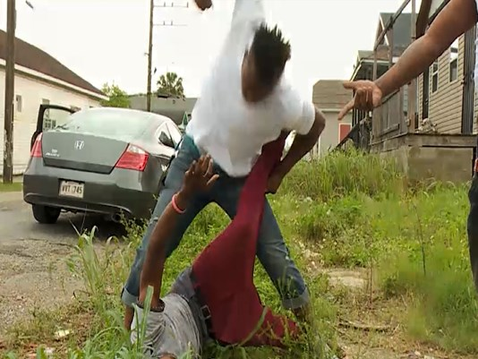 A fight broke out when a rapper objected to WWL-TV reporter Eric Paulsen's presence in his New Orleans neighborhood. Paulsen was interviewing rapper Kwame Gates about crime and gun violence. (WWL-TV Screen shot)