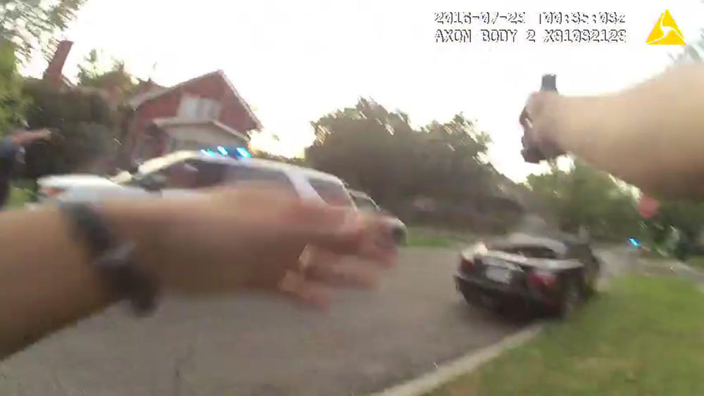 Still image from footage taken by Chicago police body camera shows the officer firing his weapon at a Jaguar convertible driven by Paul O'Neal, 18, on July 28. (Credit: Chicago Tribune)