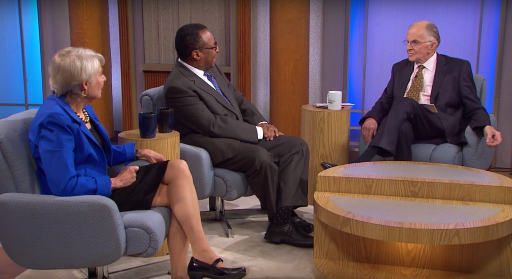 """John McLaughlin, host of """"The McLaughlin Group"""", with Eleanor Clift of the Daily Beast and Clarence Page of the Chicago Tribune during a 2015 show. (Credit: Screenshot via PBS.)"""