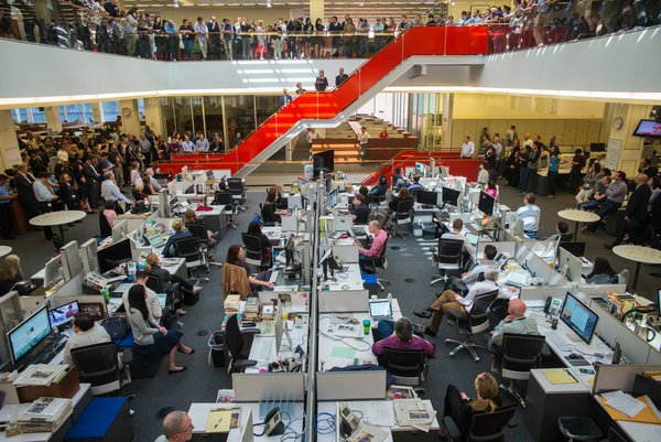 The New York Times The Times celebrates foreign correspondent Alissa J. Rubin's Pulitzer Prize as executive editor Dean Baquet and the newsroom look on last April. (Credit: Angel Franco)