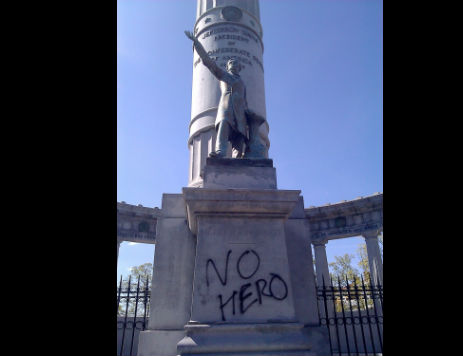 "In 2011, vandals wrote ""No Hero"" on a statue of Confederate President Jefferson Davis on Monument Avenue in Richmond, Va., where Davis is but one Confederate figure still lionized on public streets. (Credit: Doug Callahan/rvanews.com)"