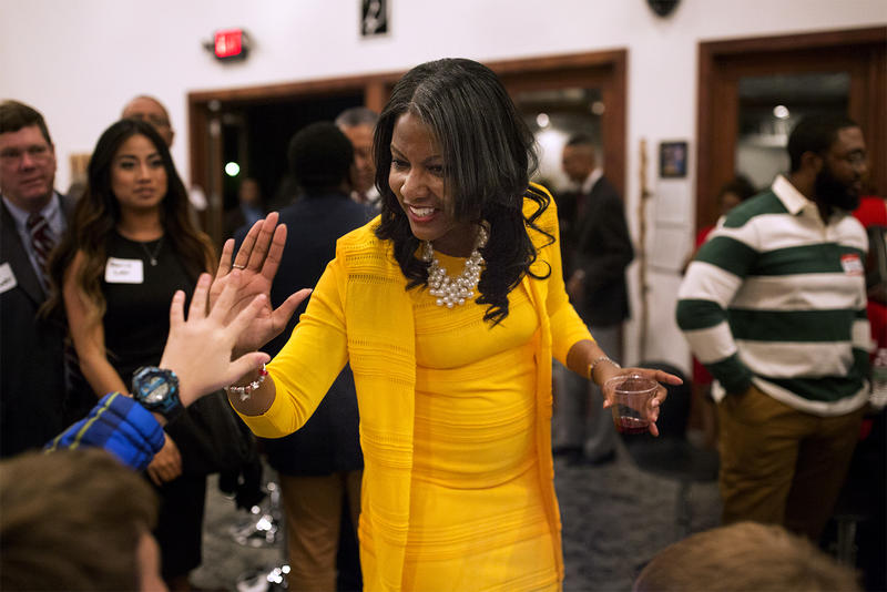 Tishaura Jones high-fives guests at a campaign kickoff party for her mayoral run in January. (Credit: (Carolina Hidalgo/St. Louis Public Radio)