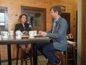 Antonia Gonzales, anchor and producer of National Native News, speaks with Matt Ehlman of the Numad Group in Rapid City, S.D. (Credit: Bart Pfankuch/Rapid City Journal)