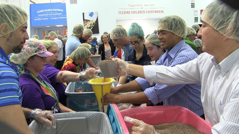 After 49 people were killed at the Pulse nightclub in Orlando on June 12, 2016, the group Feeding Children Everywhere packaged 490,000 meals with the help of volunteers. The meals were to be sent to the native countries of the people who died. (Credit: Orlando Sentinel)