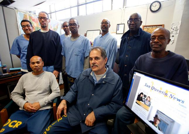 Arnulfo T. Garcia, center foreground, editor-in-chief of the San Quentin News, with his staff inside the newspaper offices in San Quentin State Prison in 2015. (Credit: Karl Mondon/Bay Area News Group) See second item.