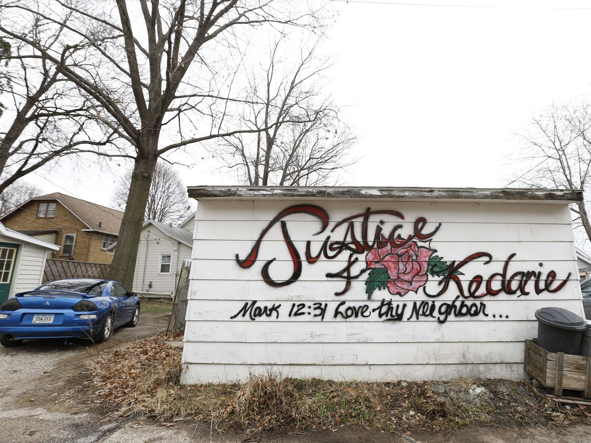 The side of a garage was tagged with a memorial for Kedarie Johnson in the alley for Kedarie Johnson in the alley where he was found dead March 2, 2016, in Burlington, Iowa. (Credit: Michael Zamora/Des Moines Register)