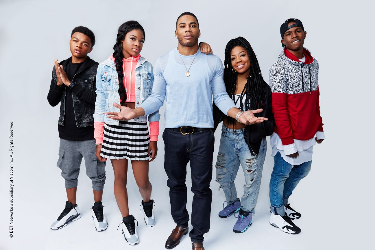 """Nelly with his family in 2914 on """"Nellyville,"""" which aired on BET. (Credit: BET)"""