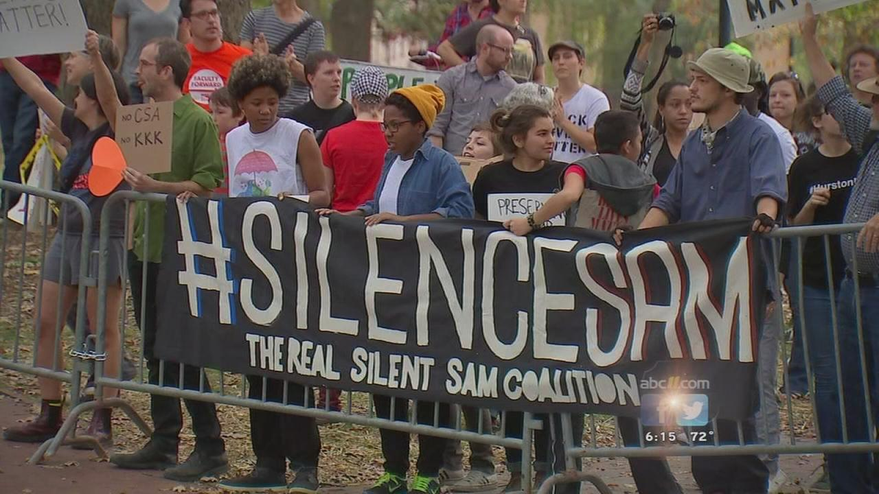 The Silent Sam statue at University of North Carolina was erected in 1913 as a memorial to UNC students who died in the Civil War. Recently, students have staged protests, as this one in 2015, seeking to remove it. Black students say it is an insult to slaves who built the original UNC campus. (Credit: WTVD-TV, Raleigh)