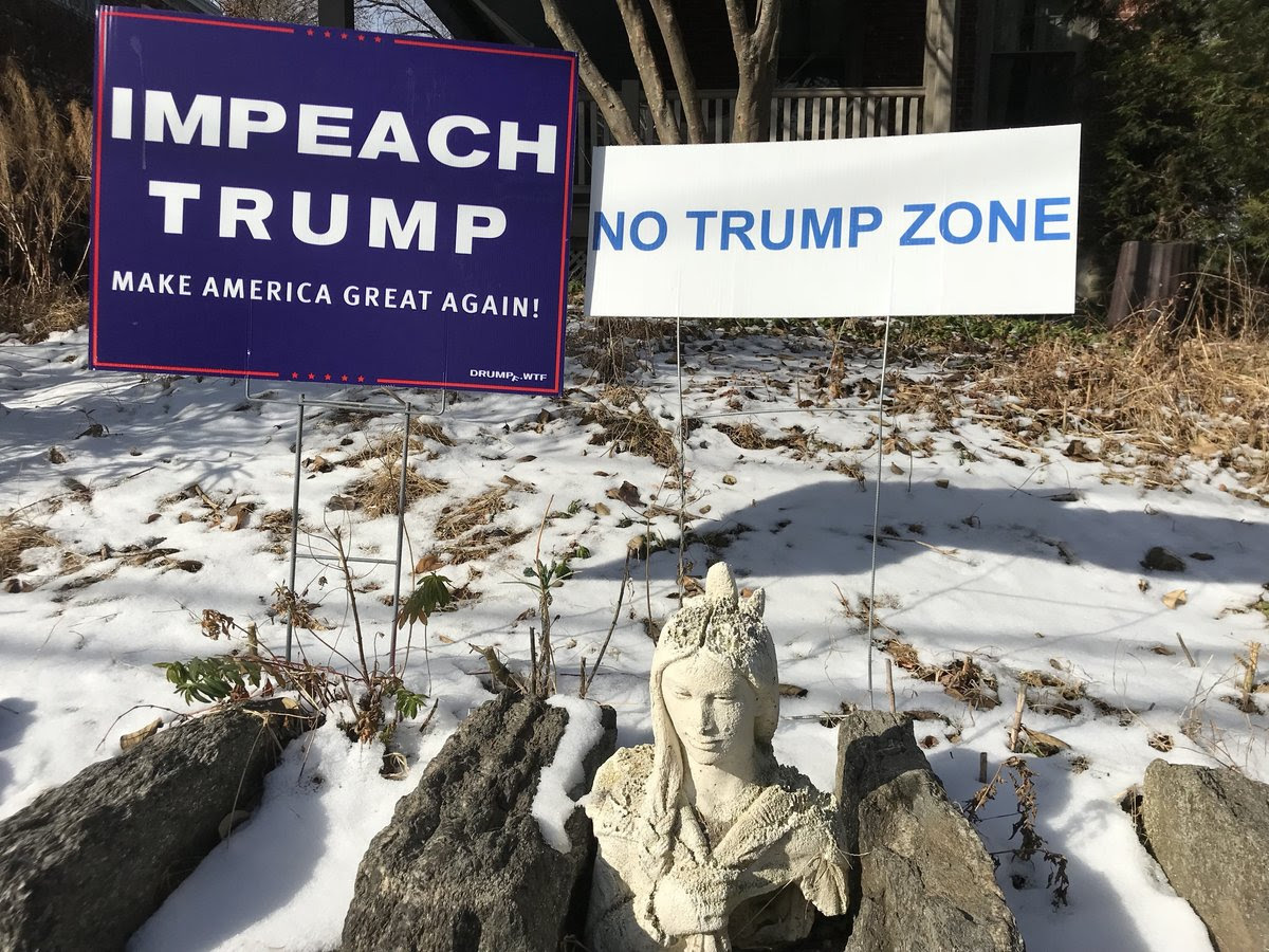It's easy to find signs like these on lawns and in windows throughout Mount Airy, the heart of Anti-Trump country, Will Bunch writes for the Philadelphia Daily News. (Credit: Will Bunch)