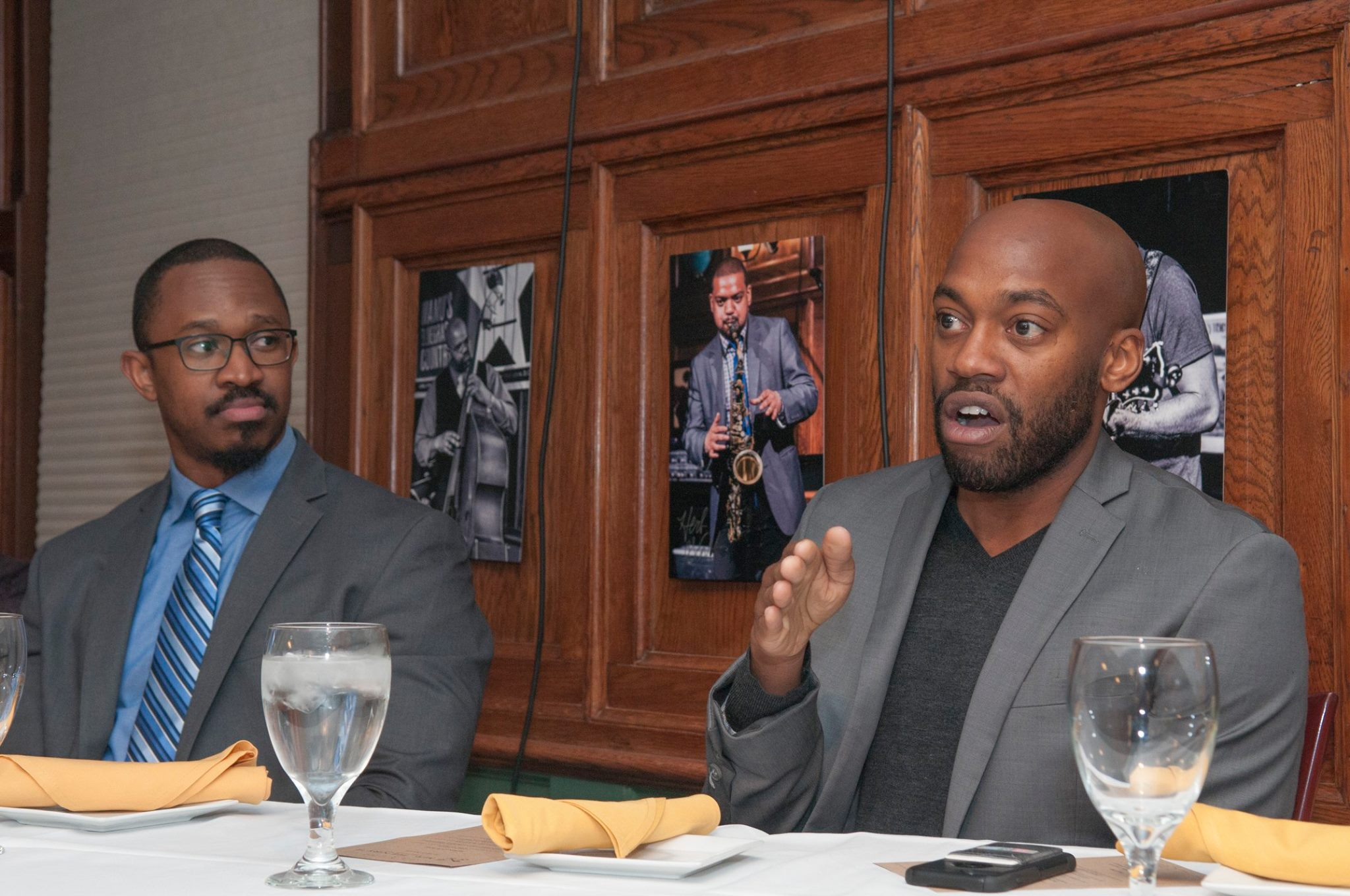 Sam Sanders says he must take charge of his own career as Joshua Johnson watches at Tuesday's Journal-isms Roundtable in Washington on Tuesday. (Credit: George Dalton Tolbert IV)