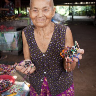 Cambodian grandmother selling bracelets
